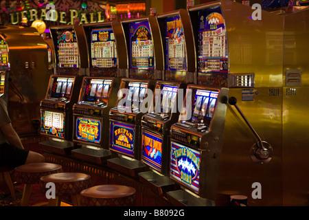 Slot machines in casino on Royal Caribbean Navigator of the Seas cruise ship - Stock Photo