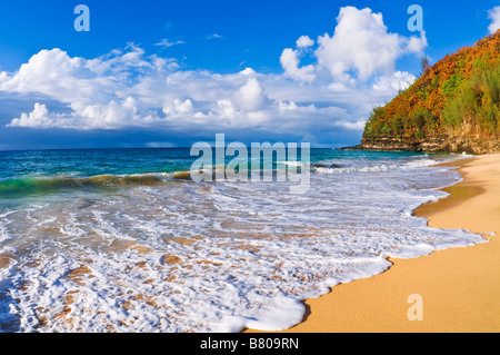 Sand and surf at Hanakapi'ai Beach along the Kalalau Trail Na Pali Coast Island of Kauai Hawaii - Stock Photo