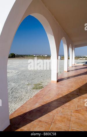 Gallery of the Agia Thekla chapel on the beach of Mediterranean sea near Aiga Napa, South Cyprus - Stock Photo
