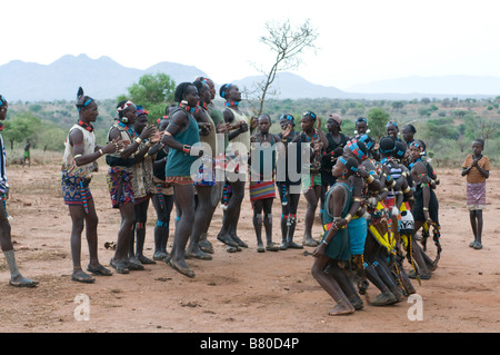 Young tribal Hamer boys and girls preparing the jumping of the bulls ceremony,Omovalley,Ethiopia,,Africa - Stock Photo