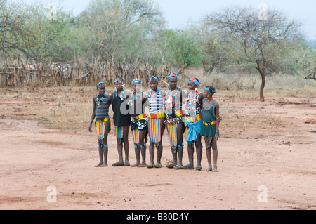 Young tribal Hamer boys and girls preparing the jumonig of the bulls ceremony,Omovalley,Ethiopia,,Africa - Stock Photo