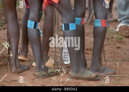 Legs of tribal Hamer men with the jumping of the bull ceremony Ethiopia Africa - Stock Photo
