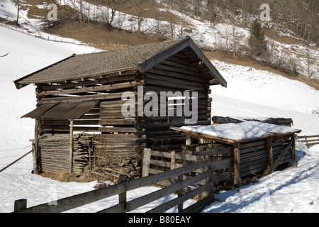 Pinzgau Region Austria EU January Chopped wood ready to heat houses stored in a wooden shed - Stock Photo