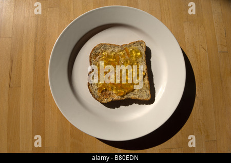 A slice of toast and marmalade on a plate. - Stock Photo
