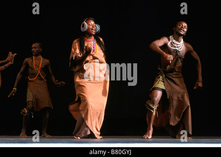 African Dancers and Singers from Cote d'Ivoire (Ivory Coast) in West Africa performing on Stage in Traditional Costume - Stock Photo