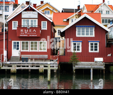 Red wooden traditional buildings at harbour in Fjallbacka on Bohuslan coast in West Gotland Sweden 2009 - Stock Photo