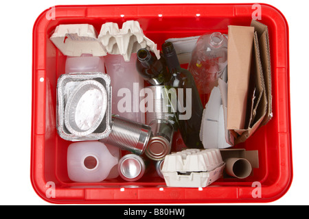 various items of household waste placed in a kerbie kerbside collection bin for recycling including aluminium food - Stock Photo