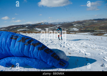 A paraglider pilot prepares to take off in Mid Wales Powys Wales United Kingdom Europe - Stock Photo
