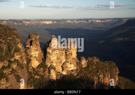 Late Afternoon Light on The Three Sisters and Jamison Valley Katoomba Blue Mountains New South Wales Australia - Stock Photo