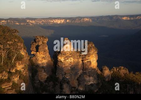 Last Light on The Three Sisters Katoomba Blue Mountains New South Wales Australia - Stock Photo