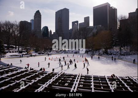 Ice skating in Central Park, New york - Stock Photo