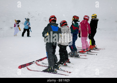 Children, boys & girl learning to ski on the snow slopes at Glenshee Sking Resort Scotland's premier extensive snowsports - Stock Photo