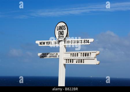 Signpost at Land s End Penwith peninsula Cornwall England United Kingdom - Stock Photo