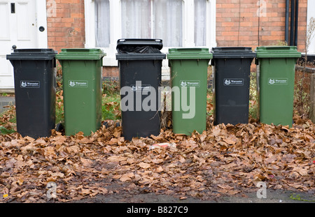 Domestic waste and recycling wheelie bins lined up outside houses in Worcestershire - Stock Photo