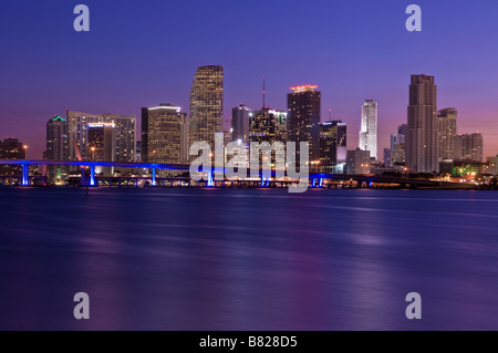 Downtown Miami Florida skyline and business district along Biscayne Bay at dawn - Stock Photo