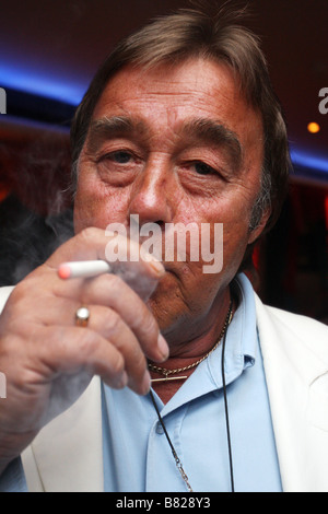 Man smoking an electronic cigarette following the smoking ban in enclosed spaces. - Stock Photo