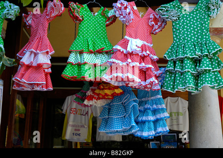 Childrens traditional flamenco dresses displayed outside shop, Seville, Spain. - Stock Photo