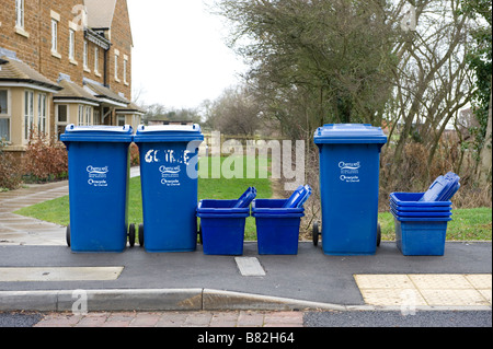 A row of domestic recycling wheelie bins and collection boxes in Oxfordshire - Stock Photo