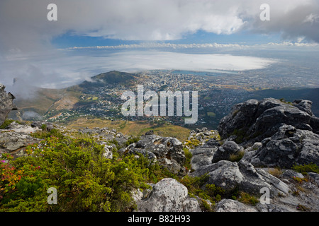 scenic view looking down from the top of table mountain onto Cape Town, South Africa - Stock Photo