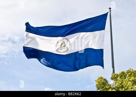 Republic of Nicaragua national flag at La Casa de Los Pueblos in Managua - Stock Photo
