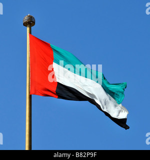 Dubai the United Arab Emirates flag at Jumeirah on the location of signing and formation of UAE - Stock Photo