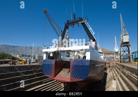 Fish trawler in a dry dock in Cape Town South Africa - Stock Photo