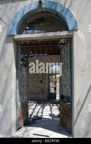 View throught the Agios Nicolas (Alasa) Church in flooded  area near Kouris Dam trough window. South Cyprus - Stock Photo