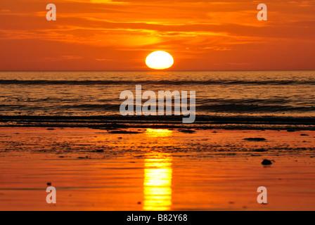 sunset over ocean - Stock Photo