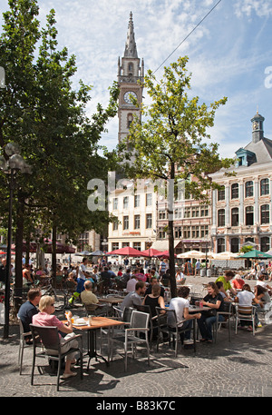 People sitting at tables in shade at pavement cafe Ghent Belgium - Stock Photo
