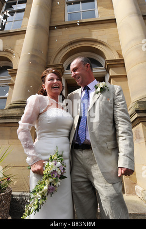 Newly wed couple outside a registry office, North Yorkshire Model Released - Stock Photo