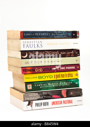 Studio shot of stack of book, literary fiction novels on white background cut out isolated - Stock Photo