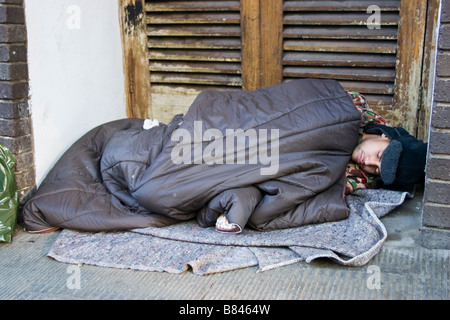 Homeless person sleeping rough in a doorway oxford - Stock Photo