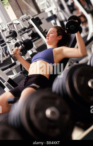 Young woman working out with Hand Weights - Stock Photo