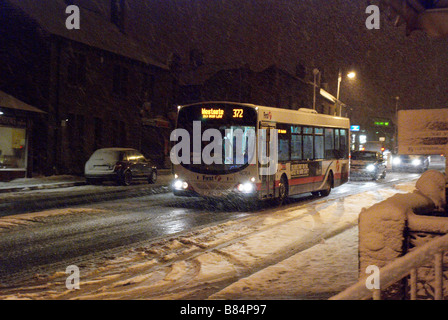Bus in a snow blizzard - Stock Photo