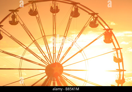 Silhouette of a ferris wheel at the 2008 Isle of Wight festival on the Isle of Wight, United Kingdom. - Stock Photo