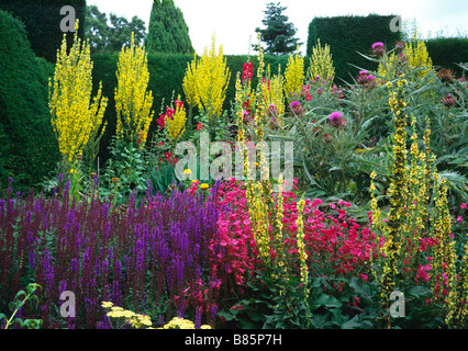 Colourful flowering summer herbaceous border at Great Dixter - Stock Photo