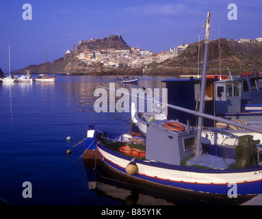 View of the old town of Castelsardo from the fishing boat harbour on the island of Sardinia - Stock Photo