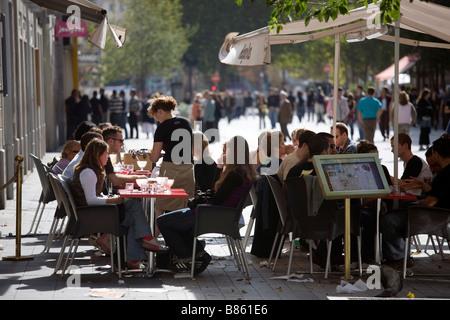 Ice cream parlor terrace on the Rue de la Republique a pedestrian street in the center of Lyon - Stock Photo