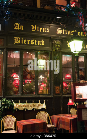 Decorated wine and beer bar at night, Christmas time, Strasbourg, Alsace, France - Stock Photo