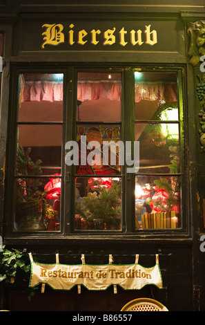 Decorated wine and beer bar window at night, Christmas time, Strasbourg, Alsace, France - Stock Photo