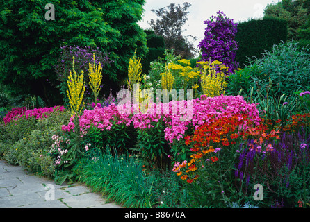 Colourful and exotic flowering summer herbaceous border at Great Dixter - Stock Photo