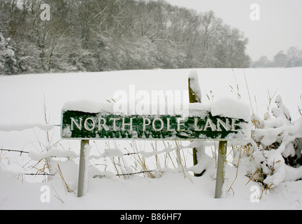 A snow covered road sign 'North Pole Lane' in Keston, Greater London, after the heaviest snowfall in 18 years. - Stock Photo