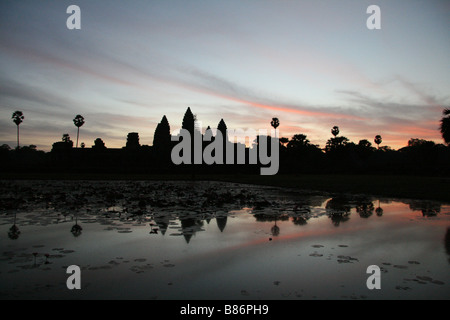 Landscape photograph of Angkor Wat temple in Cambodia at sunrise. - Stock Photo