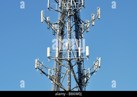 Cellular phone antennas on cell phone tower against blue sky USA - Stock Photo