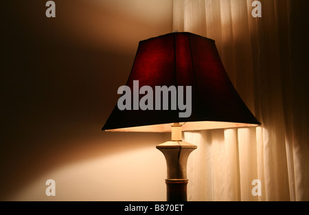 Lamp illuminating a dark room. - Stock Photo