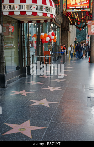 Stars embedded in the sidewalk on the Walk of Fame, Hollywood Boulevard. Hollywood, Los Angeles, California, USA. - Stock Photo