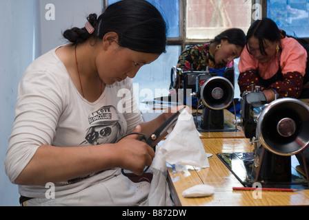 Tibetan woman taking sewing classes. - Stock Photo