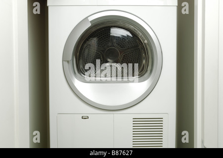 An empty laundry washing machine drying machine - Stock Photo