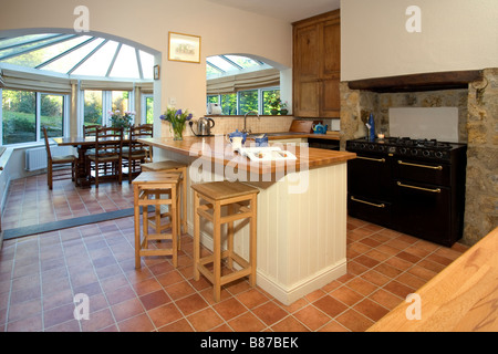 Kitchen With A Large Dining Room Conservatory Beyond