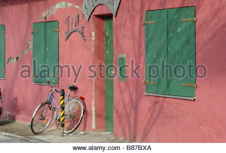 BICYCLE PARKED DOOR WOODEN - Stock Photo